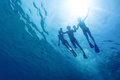 Snorkeling underwater view of friends in the tropical sea Stock Image