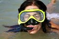 Snorkeling woman outside water Royalty Free Stock Photo