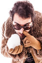 Snorting a snowball young man wearing sheepskin coat isolated over white background playing with Stock Photo