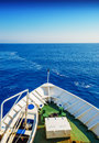 Snout of the sailing ship in open blue sea in sunny day Royalty Free Stock Photo