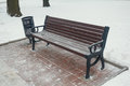 Snow on bench in park of winter Royalty Free Stock Photo