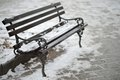 Snow on bench street covered with a cold winter day Royalty Free Stock Image
