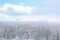 Snow blizzard over city and forest in spring Royalty Free Stock Photo