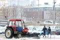 Snow blower cleans the street from snow after extreme snowstorm taken on in moscow russia Stock Photos