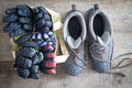 Snow boots and a bag of winter gloves and mittens Royalty Free Stock Photo