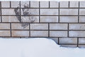 Snow and a brick wall. Royalty Free Stock Photo