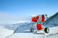 Snow canon is making snow in European Alps Royalty Free Stock Photo