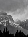 Snow capped mountain peaks with storm clouds Royalty Free Stock Photo