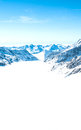 Snow capped mountains against the blue sky beautiful Stock Images