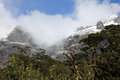 Snow capped mountains at milford sound new zealand Stock Photography