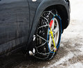 Snow chains on vehicle Stock Photos