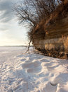 Snow and cliff frozen lake mendota sandstone Royalty Free Stock Photos