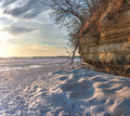 Snow and cliff frozen lake mendota sandstone at sunset Stock Photography