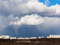 Snow clouds over city in spring day Stock Image