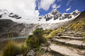 Snow-covered Andes mountains from stone stair of path Royalty Free Stock Photo