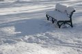 Snow covered bench in a sunny winter day empty Stock Photography