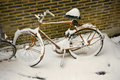 Snow-covered bike Stock Images