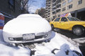 Snow covered car in streets of Manhattan, New York City, NY after winter snowstorm