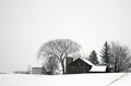 Snow covered farm Stock Photo
