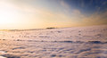 Snow-covered field. a sunset Royalty Free Stock Photo