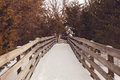Snow covered foot bridge january in starved rock state park illinois one of the many bridges spanning the canyons Stock Photo