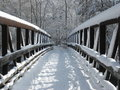 Snow covered footbridge Stock Image
