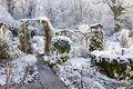 Snow covered garden wintry scene of Royalty Free Stock Images