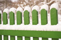 Snow covered green garden fence Stock Images