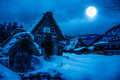 Snow covered the ground in winter. Town with night sky and full Royalty Free Stock Photo