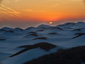 Snow covered hills on sunset background Stock Image