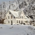 Snow-covered house in the mountains