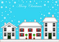 Snow-Covered Houses with Christmas Decoration Stock Images