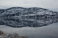 Snow covered mountain reflected in lake Royalty Free Stock Photo