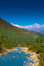 Snow covered mountains in india river ganga turns near blue winter the green around the look so amazing himalaya is amazing as Royalty Free Stock Photos