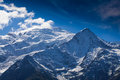 Snow covered mountains and rocky peaks in the Alps Royalty Free Stock Images
