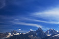 Snow covered mountains and rocky peaks in the french alps clouds Royalty Free Stock Image