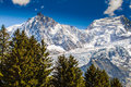 Snow covered mountains and rocky peaks in the french alps clouds Stock Photos