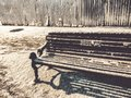 Snow Covered Park Bench. Snow covered bench in park. Snow covered bench. Winter scene. winter Park. Royalty Free Stock Photo