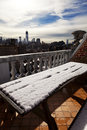 Snow covered picnic table west village rooftop porch downtown manhattan skyline background ready freedom tower Royalty Free Stock Photo