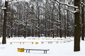 Snow covered recreation area in urban park winter Royalty Free Stock Images