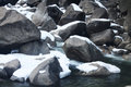 Snow covered rocks creek Stock Photo