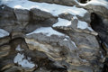 The snow covered rocks is unique texture Royalty Free Stock Images