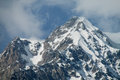 Snow covered rocky high mountain Royalty Free Stock Photo