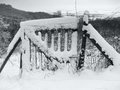 Snow covered rustic gate grey toned winter scenery with wooden in southern germany Stock Photos