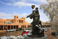Snow covered st francis statue picturesque santa fe new mexico this view of historic downtown plaza with a of of assissi Royalty Free Stock Photo