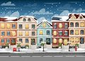 Snow-covered street with colorful houses fire hydrant lights bench red mailbox and bushes in vases cartoon style vector illustrati Royalty Free Stock Photo
