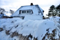 Snow covered thatched roof in winter Stock Image