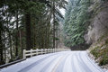 Snow covering a rural road in the pacific northwest Stock Photo