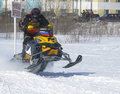 Snow cross country race nadim russia april unknown athletes snowmobile on speed jump Stock Images