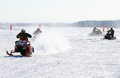 Snow cross country race nadim russia april unknown athletes snowmobile on speed jump Stock Photography